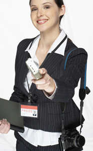 Photograph of a young woman wearing a press badge.