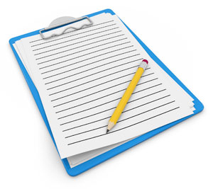 Photograph of a clipboard with paper and a pencil.