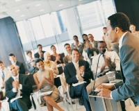 Audience applauding a speaker