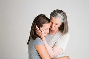 image of mother consoling daughter