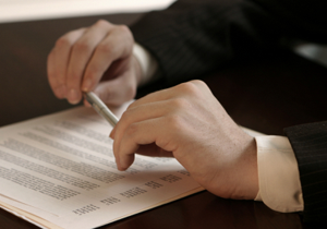 man in suit holding a pen