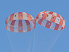 Two of Orion's three main parachutes fully inflate during the latest parachute test at the U.S. Army's Yuma Proving Ground on Tuesday, Feb. 12, 2013. Photo Credit: NASA
