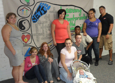 Photograph of young people in front of their completed mural.