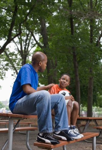 mentor and mentee sitting on a picnic table