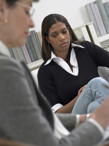 Photograph of a young woman in counseling.