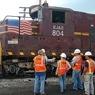 TSA workers with a train