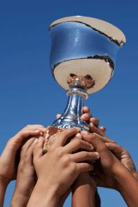 award-cup-hands