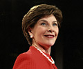 Image of Mrs. Laura Bush accepting Woman's Day Magazine Red Dress Award