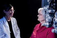 NEI Staff Clinician Nida Sen, M.D., M.H.Sc., explains the importance of clinical studies to her patients.