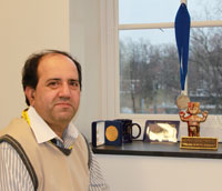 Anand Swaroop, Ph.D. in his office