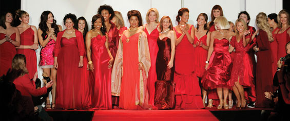 23 women in beautiful red dresigner dresses, including Phylicia Rashad standing center stage, take a final bow at the end of The Heart Truth's 2007 Fashion Show.
