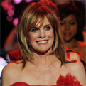 Linda Gray wears a red dress at Mercedes-Benz Fashion Week 2011