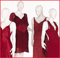 Four red dresses on mannequin display during Mercedes-Benz Fashion Week 2003