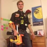 A young man holding a NERF gun.