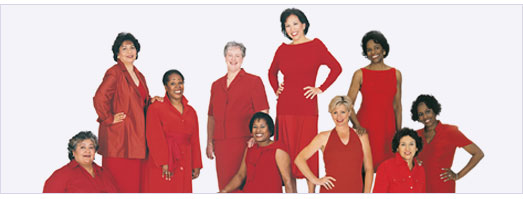 10 women of different ethnicities in red dresses and red suits, sitting and standing.
