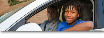 Teen and driving instructor in a car
