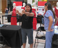 2010 Road Show - A woman tests her Body Mass Index (BMI) at The Heart Truth Road Show in Albuquerque, NM.
