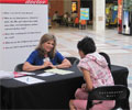 2010 Road Show - A woman consults with a doctor about heart health at The Heart Truth Road Show in Albuquerque, NM.