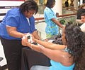 2009 Road Show - A woman tests her body mass index at The Heart Truth Road Show in Atlanta.