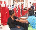 2009 Road Show - A young woman gets her blood pressure checked at The Heart Truth Road Show in Atlanta.