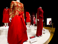 Dresses belonging to Barbara Bush (front left) and Laura Bush (front right) on display at the First Ladies Red Dress Collection on exhibit at the George Bush Presidential Library and Museum at Texas A&M University.