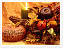 This is an image of a Thanksgiving still life with candle.