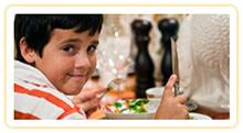 A boy eating dinner