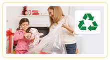 Mother and daughter recycling wrapping paper