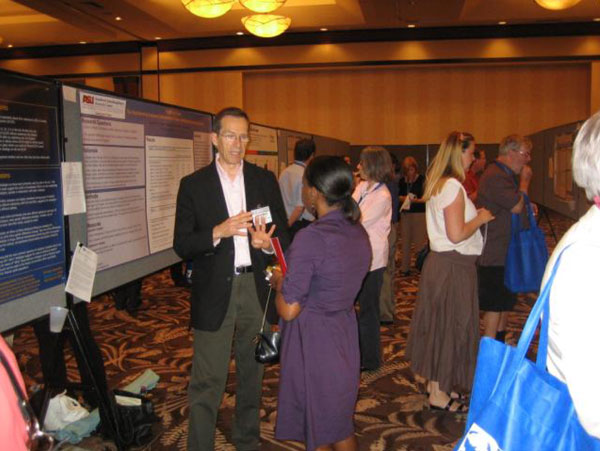 Participants at the NIDA International Research Poster Session at the SPR Annual Meeting