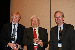 Thomas Babor, University of Connecticut and Robin Room, Australia holding their NIDA Awards of Excellence and standing next to Steve Gust, NIDA.