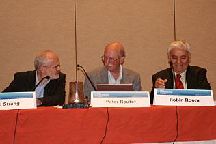John Strang, United Kingdom; Peter Reuter, University of Maryland; Robin Room, Australia, sitting at the head table of the plenary session.