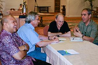 Adhi Nurhidayat, Indonesia; Dave Metzger, University of Pennsylvania; Sam Friedman, NDRI and Bijan Nassirimanesh, Canada sitting at a table conversing with each other.
