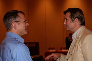 Wilson Compton, NIDA and Vladimir Poznyack, WHO speaking to each other.