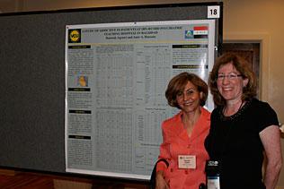 Rawnak Aqrawi, Iraq and Dale Weiss, NIDA standing together next to Rawnaks poster presentation.