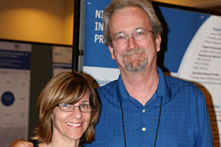 Frances H. Gabbay, USUHS and Steve Gust, NIDA standing together and smiling.
