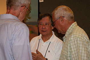 Carl Leukefeld, University of Kentucky; Walter Ling, UCLA; Clyde McCoy, University of Miami standing and talking to each other.