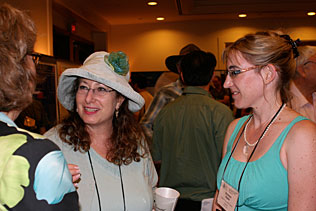 Wendee Wechsberg, RTI International and Bronwyn Myers, South Africa standing and talking to another woman.