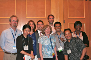 Left to right: Rear, Steve Gust, A. Ender Altintoprak, Brent Manch, Roman Gabrhelik, Hla Aung, Abimbola Onigbanjo Williams, Front, Bangone Santavasy, Dale Weiss, Ashish Sinha