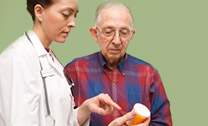 doctor showing pill instructions to patient