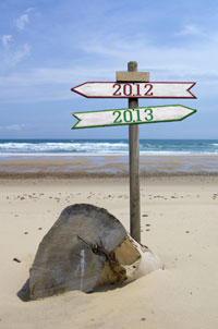 Road sign showing 2012 in one direction and 2013 in the other.