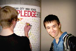 Two teen boys register for a pledge