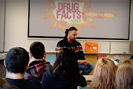 Man speaking at a Nationsl Drug Facts Week event