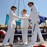 Coast Guard members shake hands.