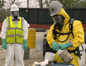 An environmental specialist carefully disposes of chemicals that Hurricane Rita spilled