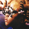 Child's Eye Exam - Lenses placed in a trial frame help determine eyeglass prescription.