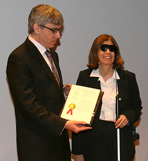 Robert J. Greenberg, M.D., Ph.D., Second Sight's president/CEO and Barbara Campbell, Argus II user.