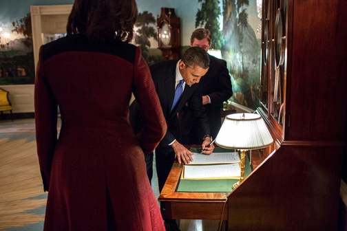 President Obama signs copies of his State of the Union address