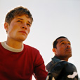 Photograph of two teen men standing together.