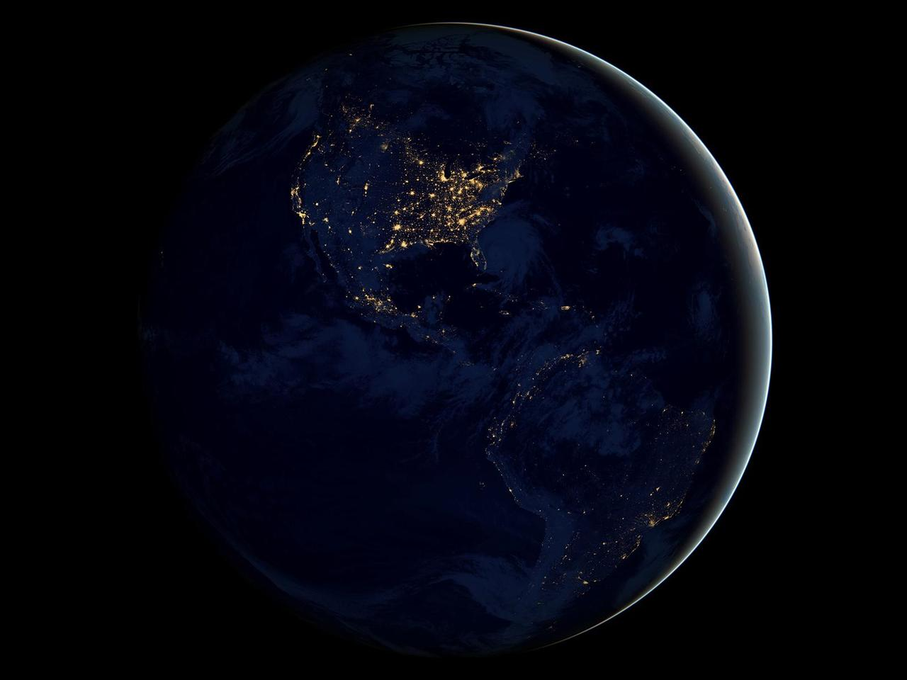 Image description: This new global view of Earth's city lights is a composite assembled from data acquired by the Suomi National Polar-orbiting Partnership (NPP) satellite. The data was acquired over nine days in April 2012 and 13 days in October 2012. It took 312 orbits to get a clear shot of every parcel of Earth's land surface and islands. This new data was then mapped over existing Blue Marble imagery of Earth to provide a realistic view of the planet. View a larger image. Image from NASA's Earth Observatory/NOAA/DOD