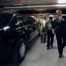 "U.S. Secret Service Director Mark Sullivan (front) and Special Agent Gregory Tate (rear) brief Secretary Napolitano on the presidential limousine nicknamed ""The Beast."""